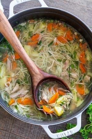 A pot of chicken noodle soup
