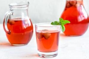 Kompot beverage in a jar and a cup