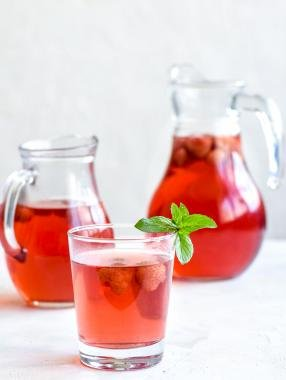 Kompot in a jar and a glass cup