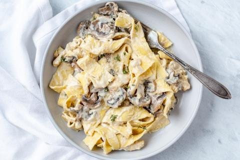 Mushroom Fettuccine Alfredo in a plate with a fork