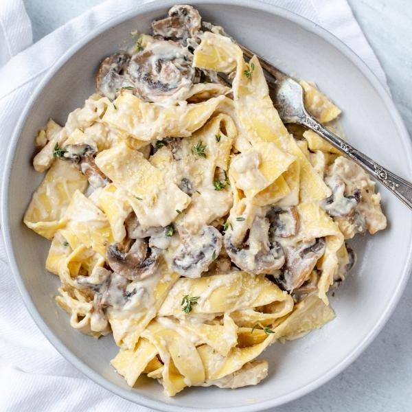 Mushroom Fettuccine Alfredo in a plate with a fork