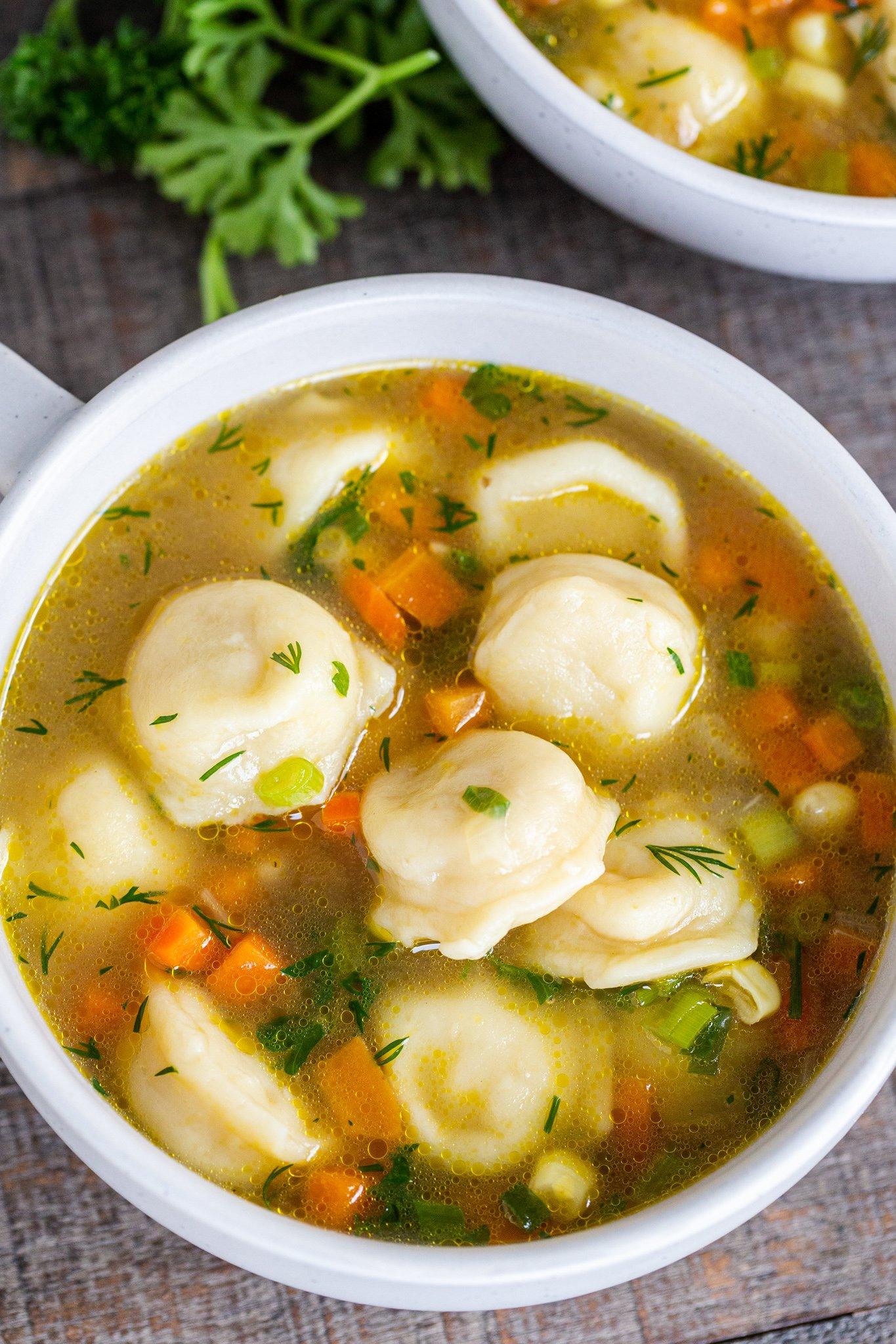 Pelmeni soup in a bowl