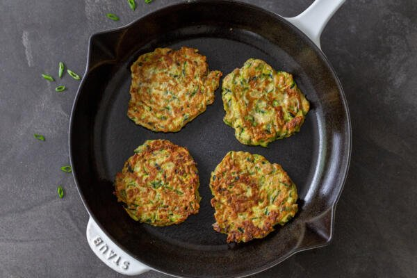 Zucchini fritters in a pan