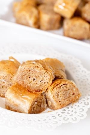 Rolled Baklava stacked on top of each other in a bowl