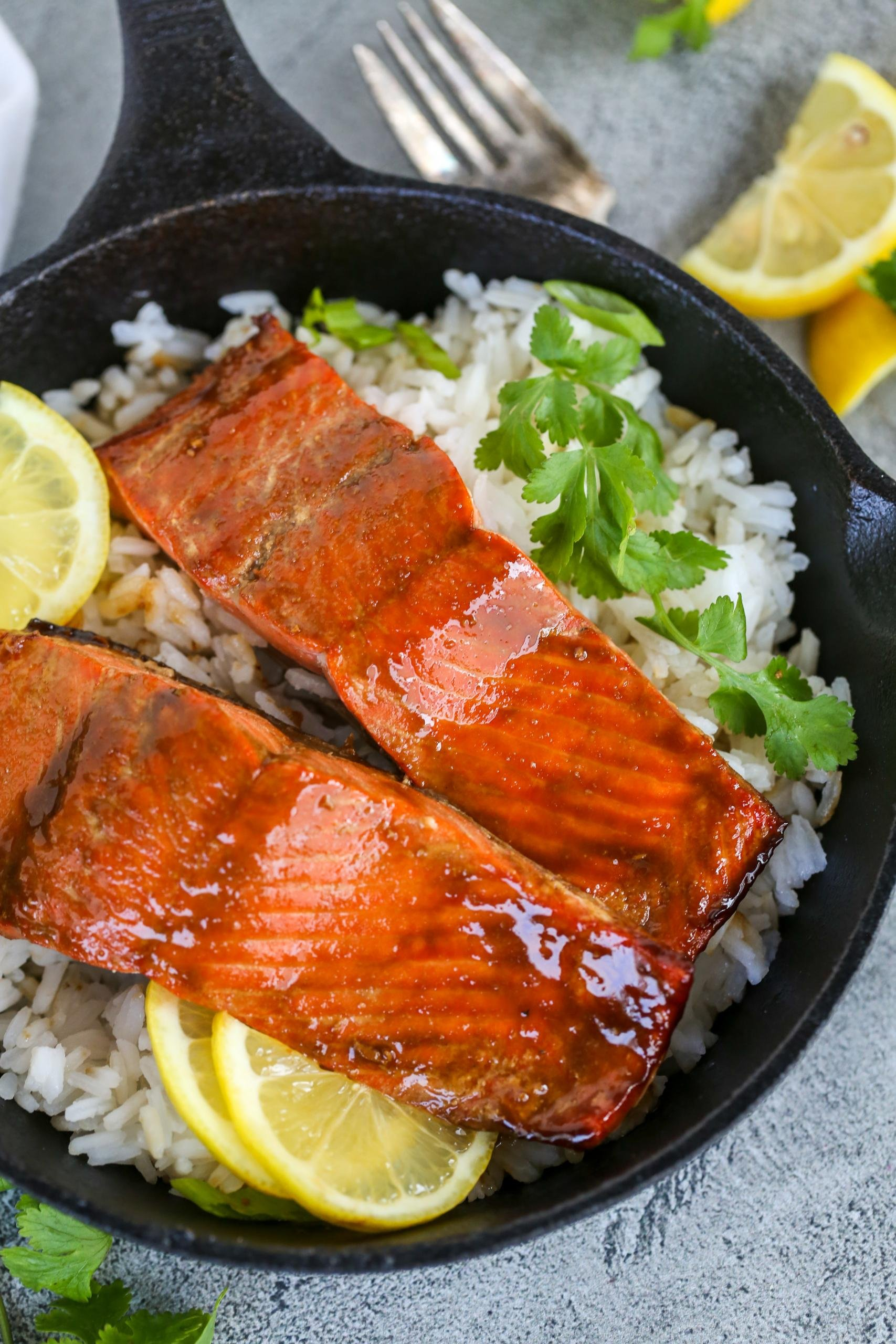 Brown Sugar Glazed Salmon in a skillet with rice