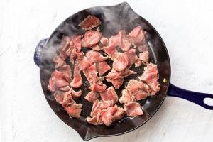beef getting cooked in the skillet