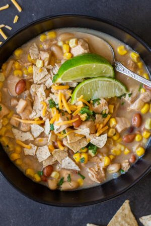 White Chicken Chili in a bowl with lime and chips