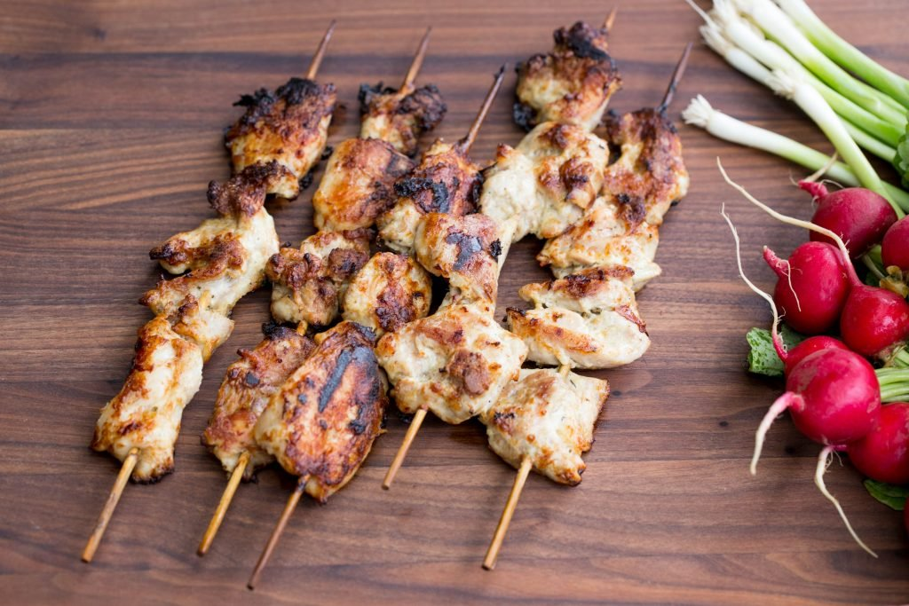 Grilled chicken kabobs on a cutting board