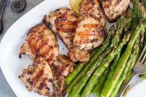 Grilled chicken on a plate with asparagus