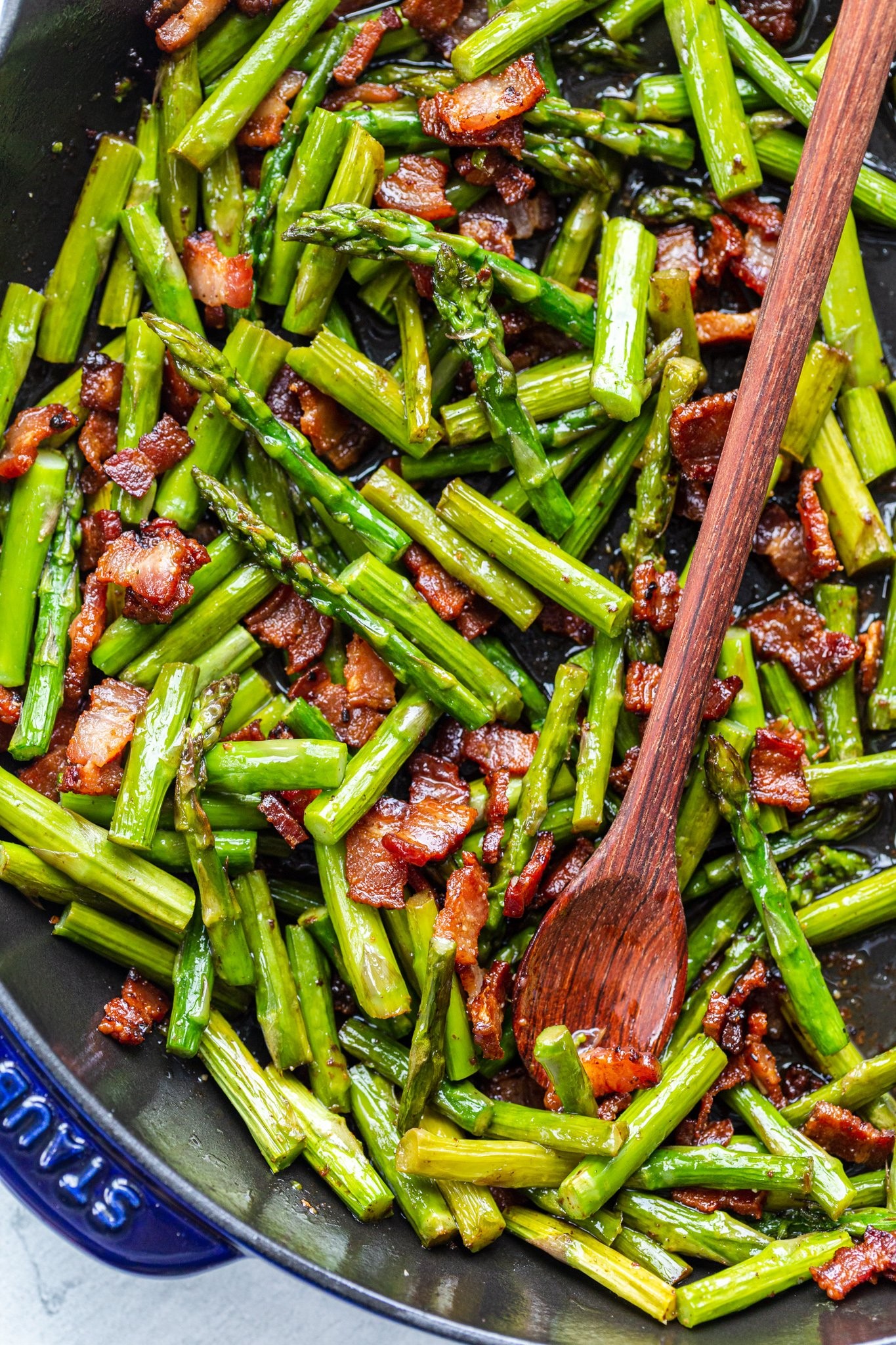 asparagus and bacon in a frying pan
