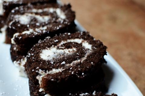 Chocolate honey roll slices on a plate