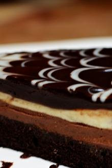 A slice of black tie mousse cake on a plate