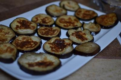 Cooked eggplant cut circles on plate