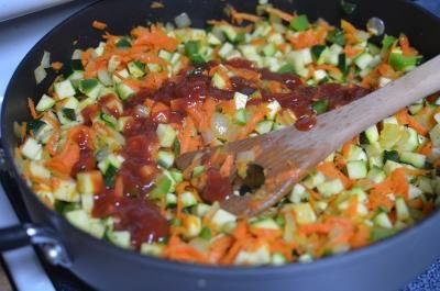 Vegetables in a skillet with ketchup