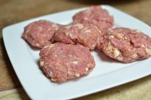5 beef patties each about 3/4 of an inch thick all on a plate