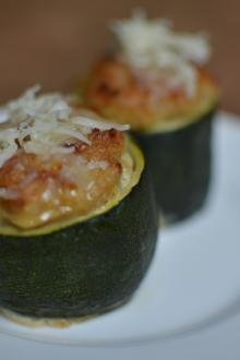 2 stuffed zucchinis cups on a plate