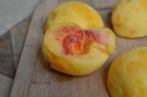 Peaches halved and skinned