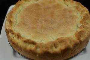 Plum Pie cooked, cooling on a plate