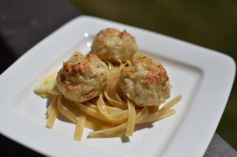 Oatmeal Meatballs on top of pasta on a plate