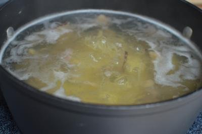Pot with soup boiling
