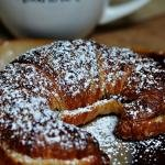 Twice Baked Chocolate Croissant with powered sugar on top