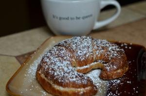Twice Baked Chocolate Croissant with powered sugar on top on a plate