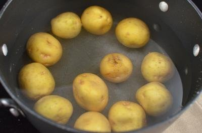Potatoes in a pot filled with water on the stove