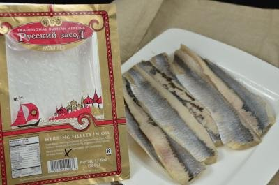 Herring taken out of the packaging and placed on a plate