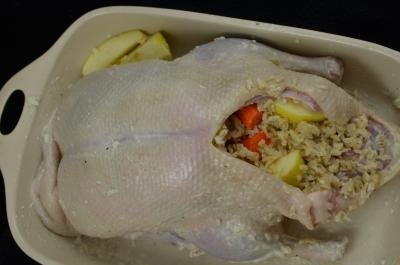 Duck being stuffed with homemade stuffing