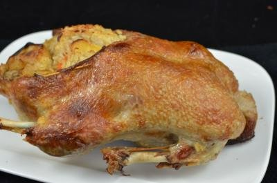 Roasted Stuffed Duck on a large serving plate
