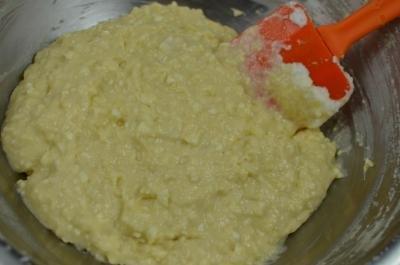 Farmer's Cheese Doughnut dough in a bowl with a spatula
