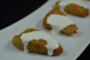 Cabbage Rolls with sour cream on top on a plate