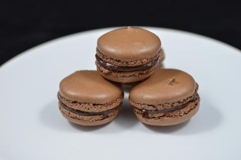 4 Chocolate Macarons on a plate