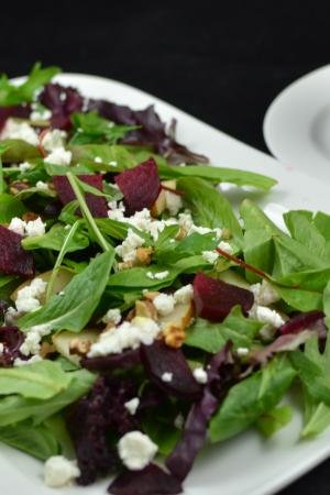 Beet Garden Salad with Goat Cheese on a plate