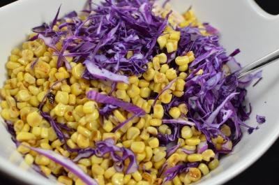 Corn, red cabbage and chicken slices in a bowl