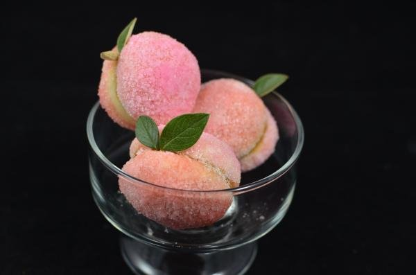 3 peach cookies in a small glass decorative bowl