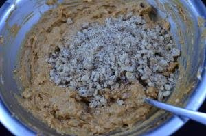 Dulce de leche, together with cookie crumbs and crushed walnuts mixed together in a bowl