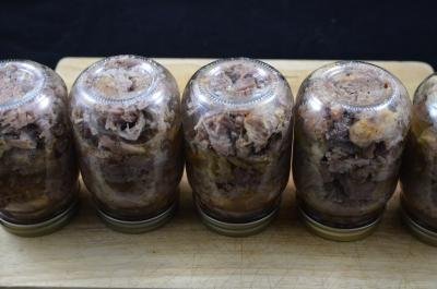 5 jars upside down full of canned Stewed Meat