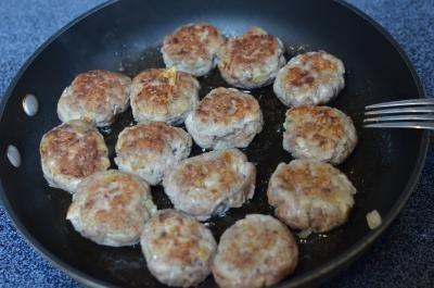 Meatballs frying in a skillet