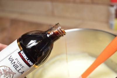 Vanilla extract being added into bowl with dough mixture