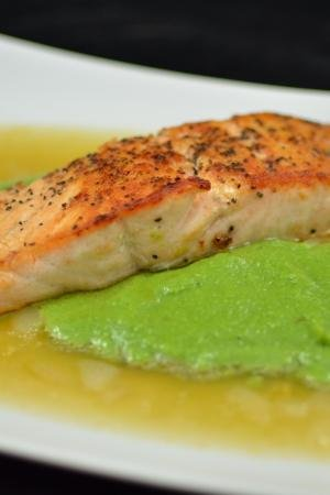 Salmon in Lemon Brodetto with Pea Puree on a plate