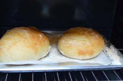 2 loaves of no knead bread baking in the oven