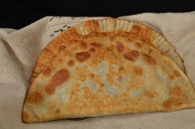 Russian pastry Chebureki resting on a paper towel