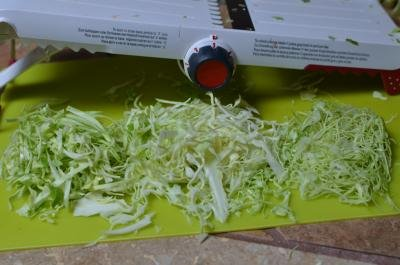 Shredded cabbage on a cutting board