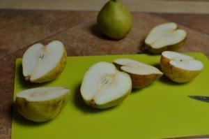 Pears cut in half on a cutting board