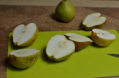 Pears cut in half on a cutting board