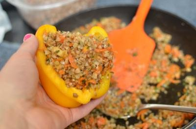 Bell pepper being stuffed with the filling