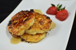 Cottage Cheese Pancakes stacked on a plate