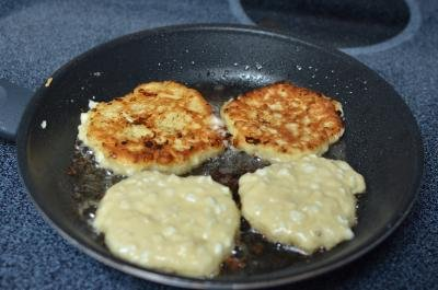 4 cottage cheese pancakes frying on a skillet