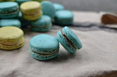 A pile of green and blue macarons